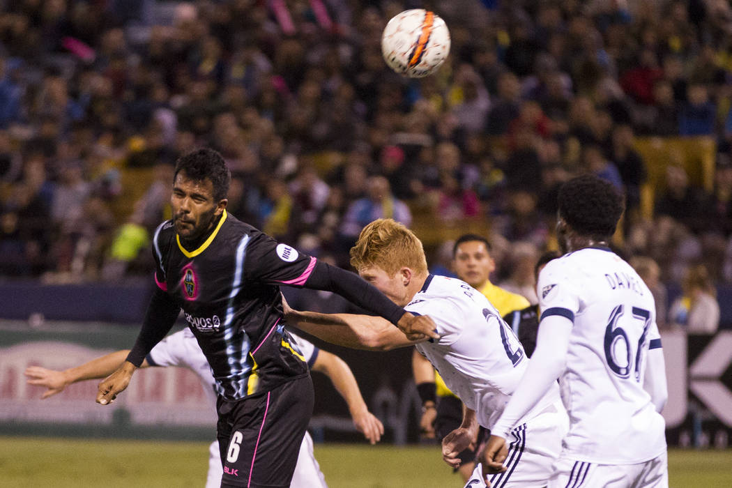 Las Vegas Lights FC's Miguel Angel Gardun~o (6) connects with the ball against Vancouver Whitecaps FC in the soccer game at Cashman Field in Las Vegas, Saturday, Feb. 17, 2018. Erik Verduzc ...