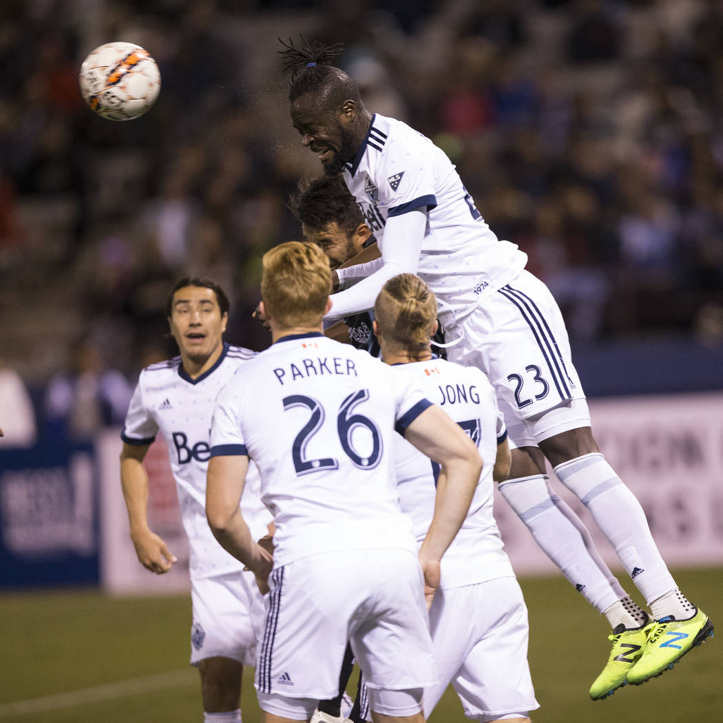 Vancouver Whitecaps FC's Kei Kamara (23) clears the ball from the goal box against Las Vegas Lights FC in their soccer game at Cashman Field in Las Vegas, Saturday, Feb. 17, 2018. Erik Verd ...
