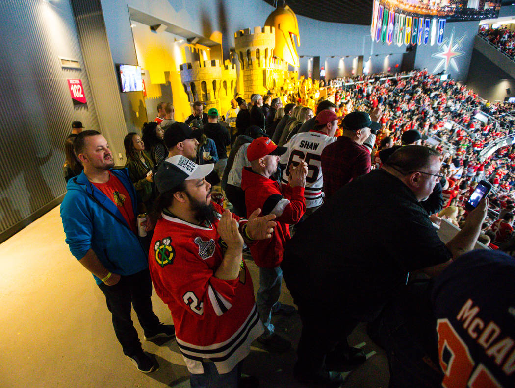 Chicago Blackhawks fan Chris Reyes, center, cheers after his team scored against the Golden Knights during an NHL game at T-Mobile Arena in Las Vegas on Tuesday, Feb. 13, 2018. Chase Stevens Las V ...