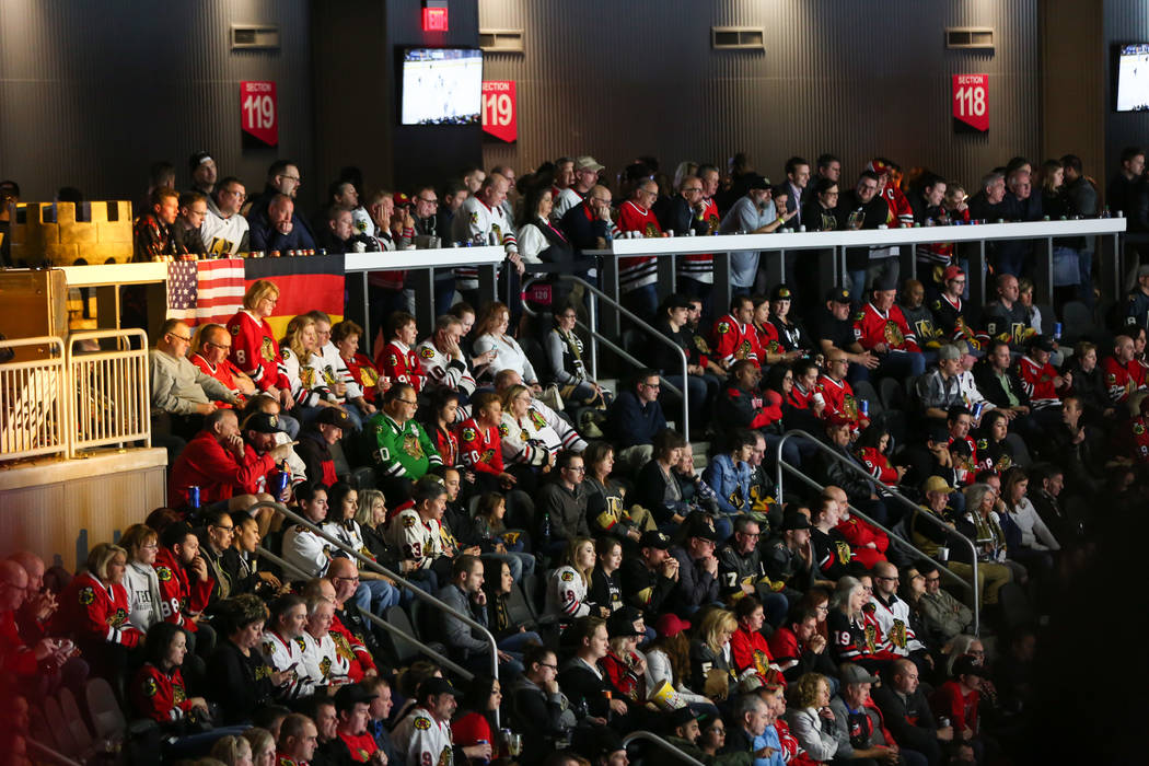 Hockey fans take in the action from the standing room only area, seen above, as the Golden Knights play the Chicago Blackhawks during an NHL game at T-Mobile Arena in Las Vegas on Tuesday, Feb. 13 ...
