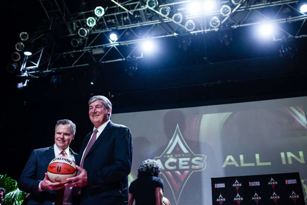 Chairman and CEO of MGM International Jim Murren, left, and Las Vegas Aces head coach Bill Laimbeer, right, gather during the reveal of the Las Vegas Aces WNBA basketball team at the House of Blue ...