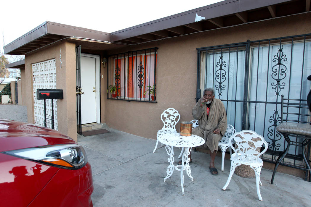 James Madison smokes a cigarette butt outside in his Las Vegas home Feb. 19, 2018. Madison was placed in the unlicensed group home for people with mental illness by Eileen Lee. K.M. Cannon Las Veg ...