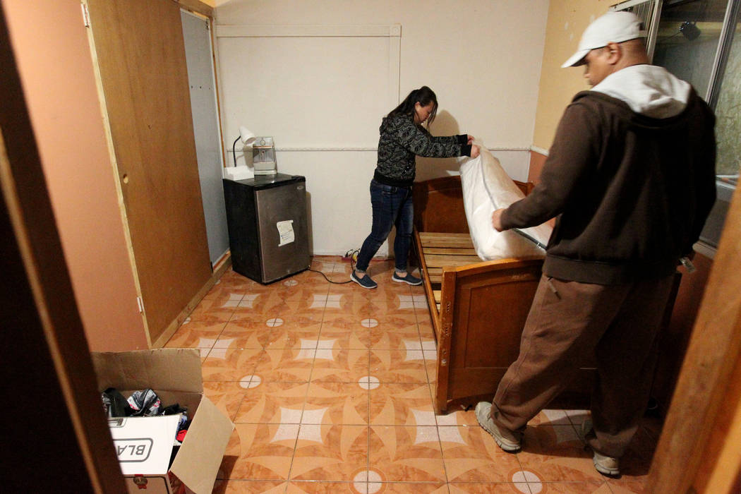 """Treva Lee, left, and Jersharo Amey look for belongings Wednesday, Feb. 21, 2018, in the room of Rayshauna Roy, who they found dead in the room of the Las Vegas """"independent living"""" home where they ..."""
