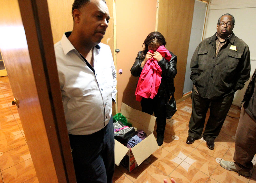 The family of Rayshauna Roy, from left, father Tony Wright, mother Netshield Roy and uncle Dwayne McCarther, go through her belongings Wednesday, Feb. 21, 2018, in her room of the Las Vegas &q ...