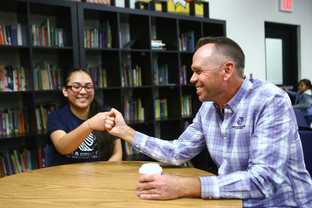 "Kaprice Burns, left, a 16-year-old student at Spring Valley High School who was named ""Youth of the Year"" by the Boys & Girls Clubs of Southern Nevada, fist bumps Andy Bischel, president/CEO o ..."
