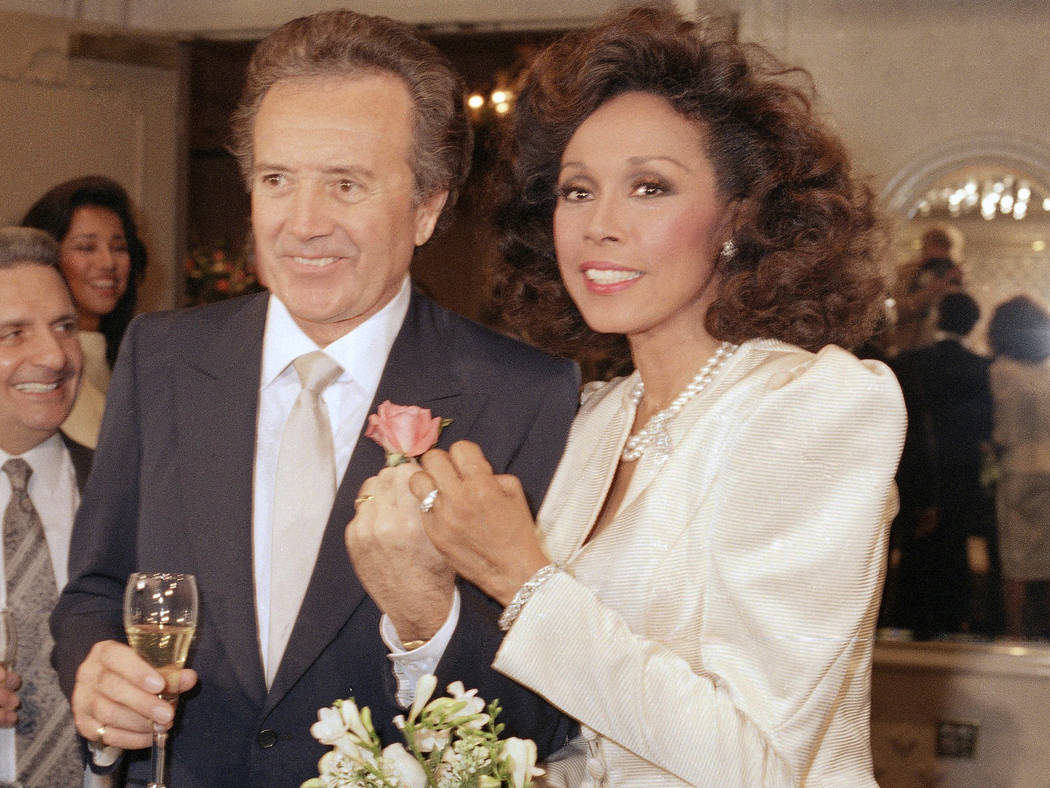 In this Jan. 3, 1987 file photo, Vic Damone, left, and Diahann Carroll show off their rings after wedding in Atlantic City, N,J. Damone died Sunday, Feb. 11, 2018, at a Miami Beach hospital from c ...