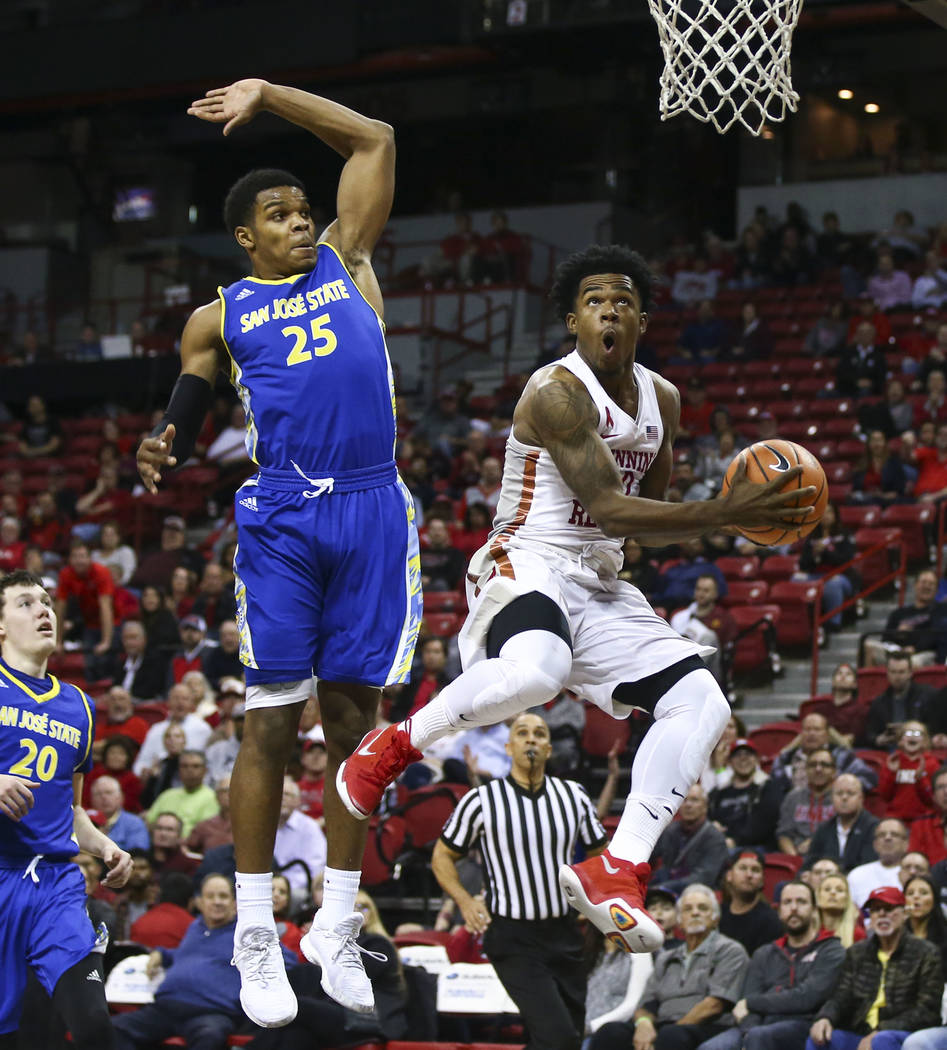 UNLV Rebels guard Jovan Mooring (30) goes up to score past San Jose State Spartans guard Jaycee Hillsman (25) during a basketball game at the Thomas & Mack Center in Las Vegas on Wednesday, Ja ...