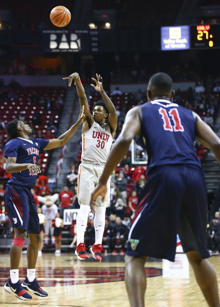 UNLV Rebels guard Jovan Mooring (30) shoots against the Fresno State Bulldogs during the first half of a basketball game at the Thomas & Mack Center in Las Vegas on Wednesday, Feb. 21, 2018. C ...