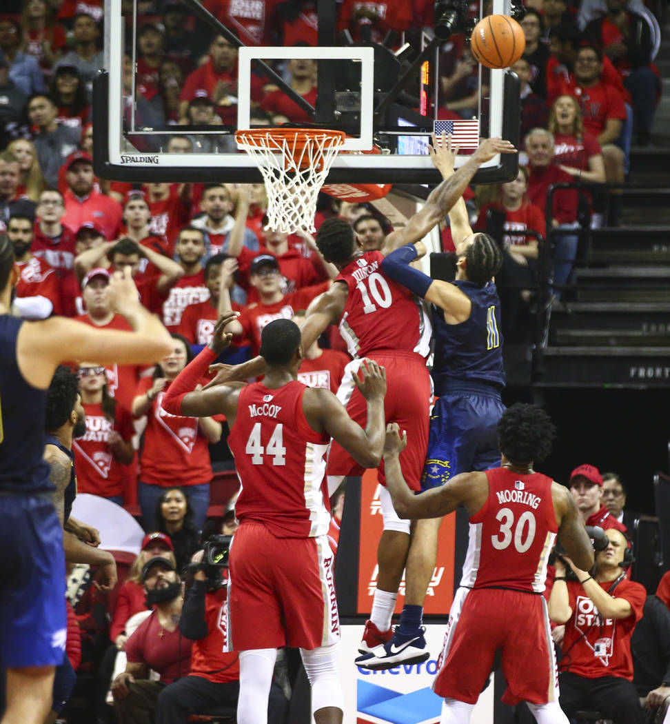 UNLV forward Shakur Juiston (10) blocks a shot from UNR forward Cody Martin (11) during the first half of a basketball game at the Thomas & Mack Center in Las Vegas on Wednesday, Feb. 28, 2018 ...