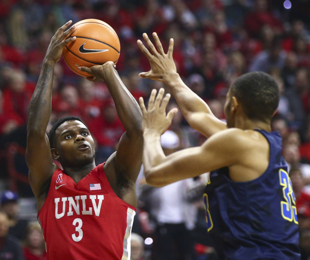 UNLV guard Amauri Hardy (3) shoots over UNR guard Josh Hall (33) during the first half of a basketball game at the Thomas & Mack Center in Las Vegas on Wednesday, Feb. 28, 2018. Chase Stevens  ...
