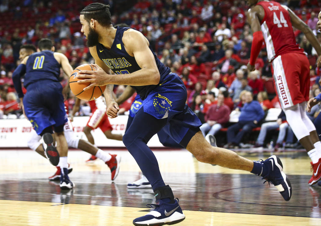 UNR forward Caleb Martin (10) gets control of the ball over UNLV during the second half of a basketball game at the Thomas & Mack Center in Las Vegas on Wednesday, Feb. 28, 2018. UNR won 101-7 ...
