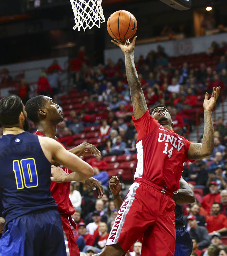 UNLV forward Tervell Beck (14) sends up a shot during the second half of a basketball game at the Thomas & Mack Center in Las Vegas on Wednesday, Feb. 28, 2018. UNR won 101-75. Chase Stevens L ...