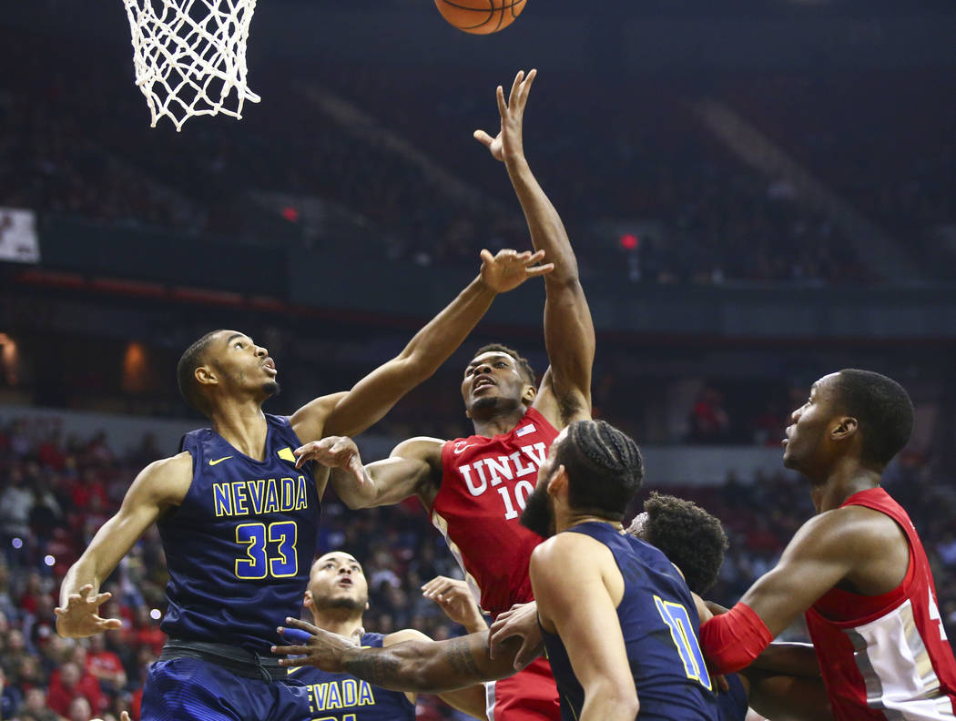 UNLV forward Shakur Juiston (10) sends up a shot over UNR guard Josh Hall (33) during the first half of a basketball game at the Thomas & Mack Center in Las Vegas on Wednesday, Feb. 28, 2018.  ...