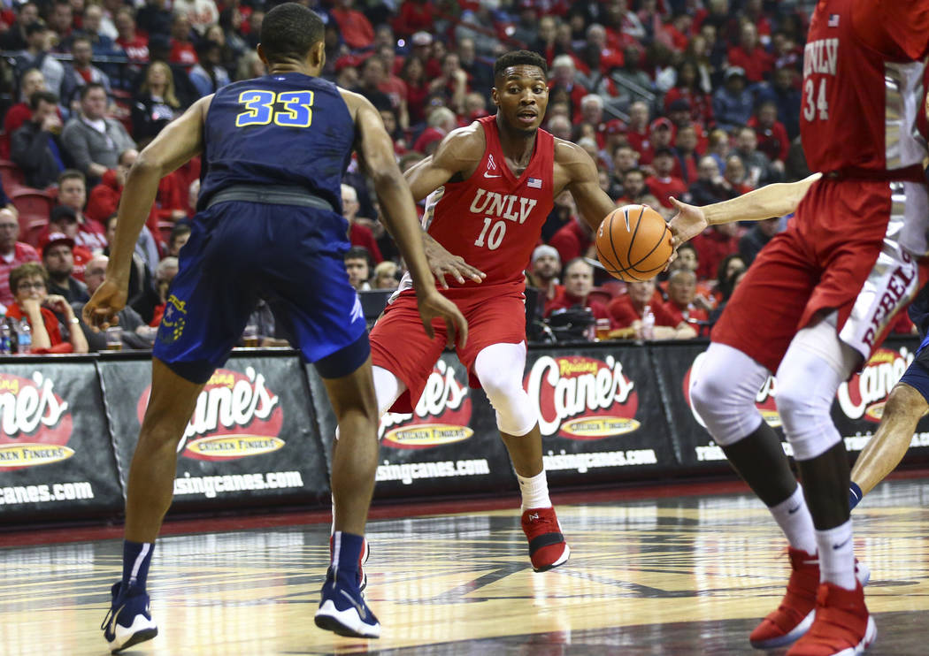 UNLV forward Shakur Juiston (10) drives against UNR guard Josh Hall (33) during the first half of a basketball game at the Thomas & Mack Center in Las Vegas on Wednesday, Feb. 28, 2018. Chase  ...