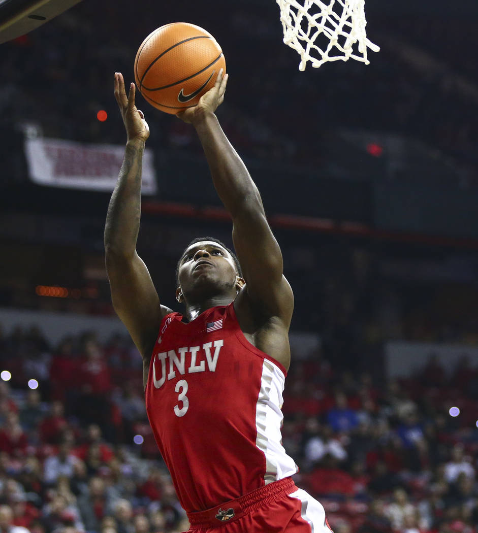 UNLV guard Amauri Hardy (3) goes to the basket against UNR during the first half of a basketball game at the Thomas & Mack Center in Las Vegas on Wednesday, Feb. 28, 2018. Chase Stevens Las Ve ...