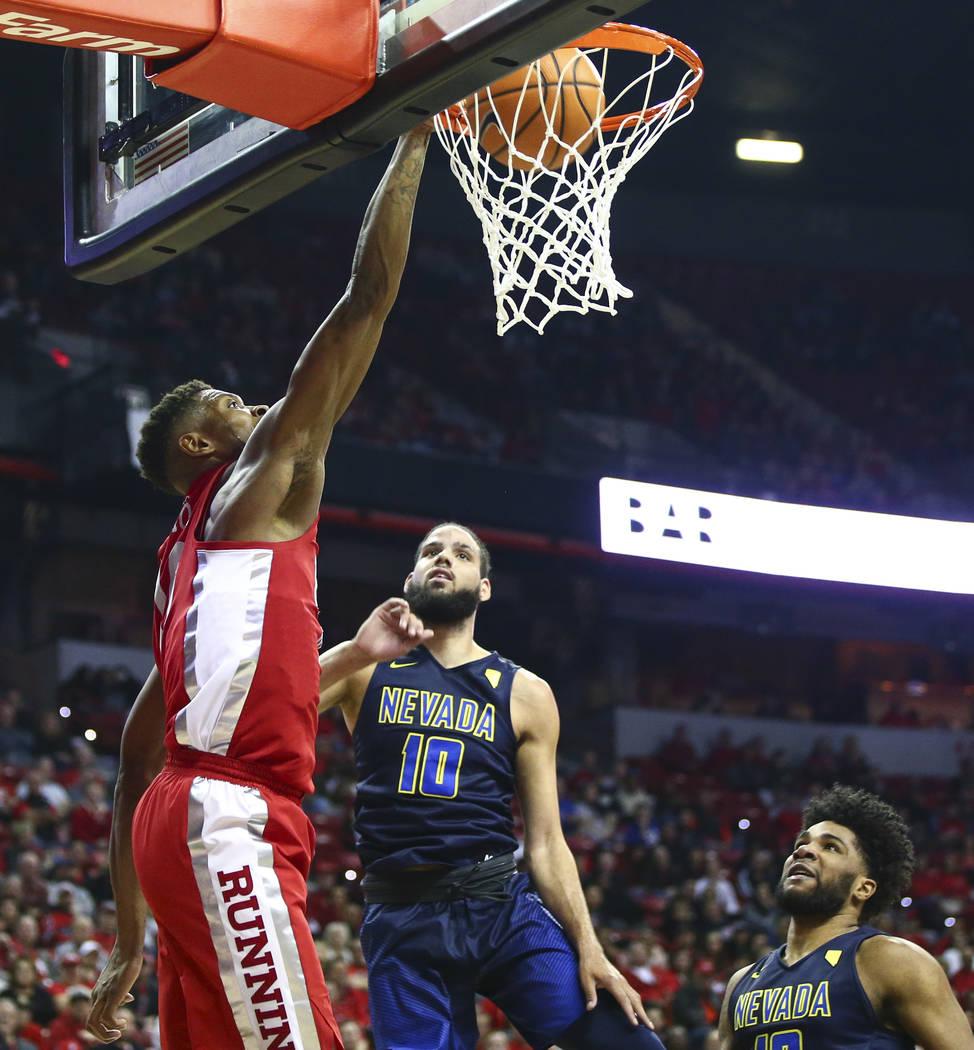 UNLV forward Shakur Juiston (10) dunks against UNR forward Caleb Martin (10) at the Thomas & Mack Center in Las Vegas on Wednesday, Feb. 28, 2018. Chase Stevens Las Vegas Review-Journal @csste ...