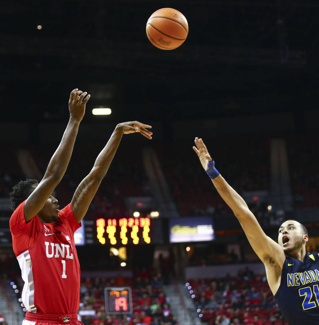 UNLV guard Kris Clyburn (1) shoots over UNR guard Kendall Stephens (21) during the second half of a basketball game at the Thomas & Mack Center in Las Vegas on Wednesday, Feb. 28, 2018. UNR wo ...