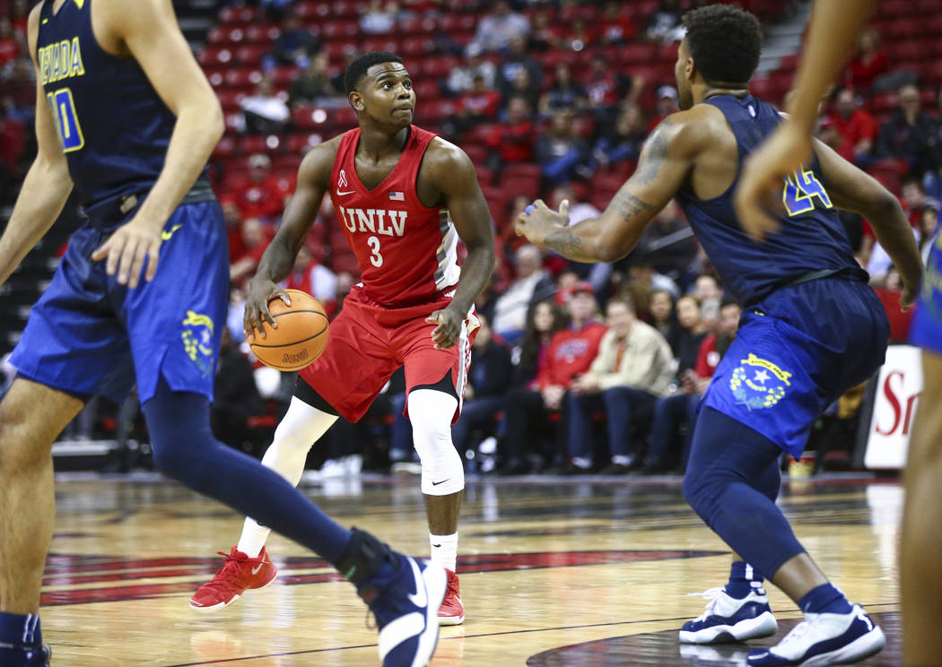 UNLV guard Amauri Hardy (3) drives the ball against UNR during the second half of a basketball game at the Thomas & Mack Center in Las Vegas on Wednesday, Feb. 28, 2018. UNR won 101-75. Chase  ...