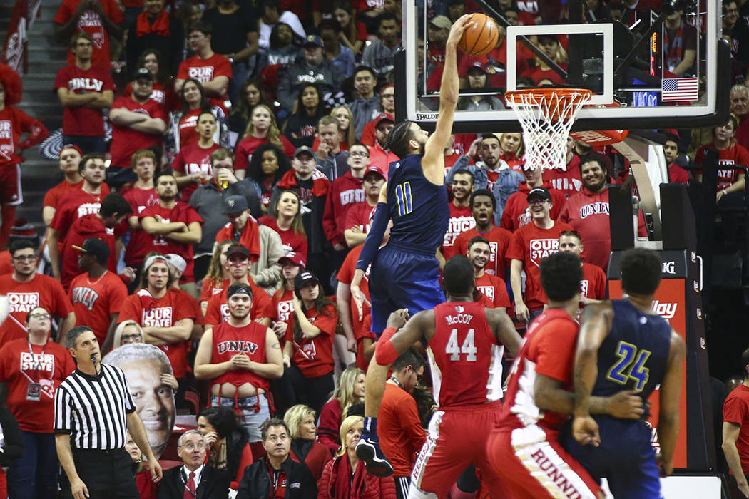 UNR forward Cody Martin (11) dunks against UNLV during the first half of a basketball game at the Thomas & Mack Center in Las Vegas on Wednesday, Feb. 28, 2018. Chase Stevens Las Vegas Review- ...