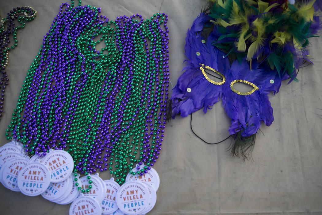 Necklaces and a mask  during the Mardi Gras Carnival at the historic Harrison House in Las Vegas, Tuesday, Feb. 13, 2018. (Erik Verduzco/Las Vegas Review-Journal) @Erik_Verduzco