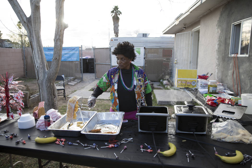 Volunteer Barbara Crockett prepares food during the Mardi Gras Carnival at the historic Harrison House in Las Vegas, Tuesday, Feb. 13, 2018. (Erik Verduzco/Las Vegas Review-Journal) @Erik_Verduzco