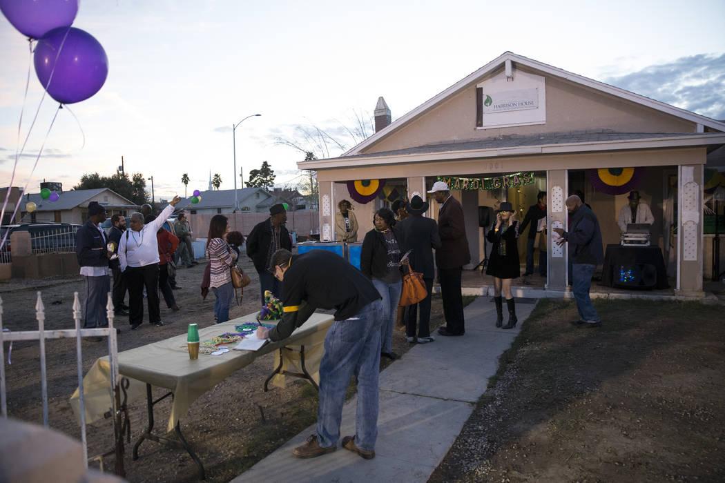 People attend the Mardi Gras Carnival at the historic Harrison House in Las Vegas, Tuesday, Feb. 13, 2018. (Erik Verduzco/Las Vegas Review-Journal) @Erik_Verduzco