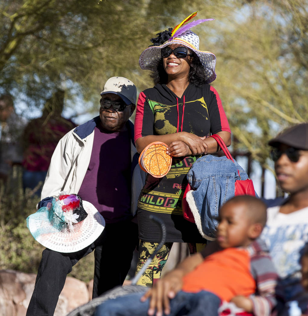 Attendees watch during a performance from the performance ensemble Molodi, who used stomping and clapping to perform, during a celebration of Black History Month at the Springs Preserve on Saturda ...