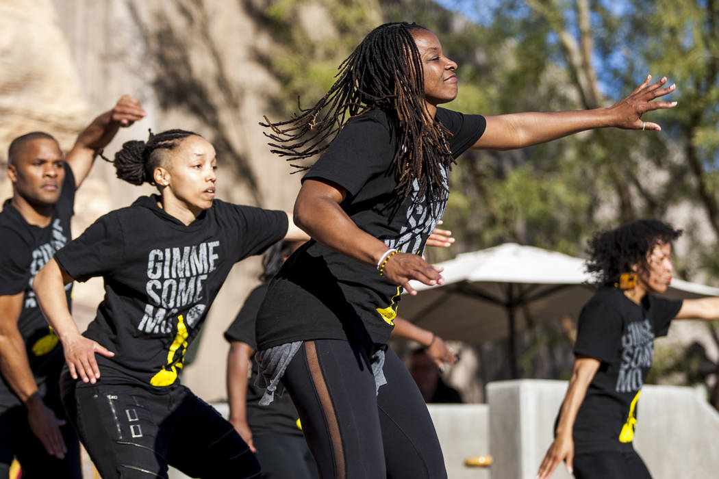 Members of Molodi, a performance ensemble, Jason Nious, from left, Angie Freeman, Cammie Griffin and Kishema Pendu Malik stomp and clap for the audience during a celebration of Black History Month ...