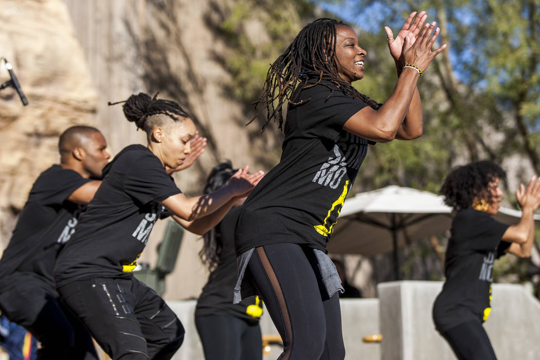 Cammie Griffin, second from right, a member of Molodi, a performance ensemble, stomps and claps along with the other performers during a celebration of Black History Month at the Springs Preserve  ...