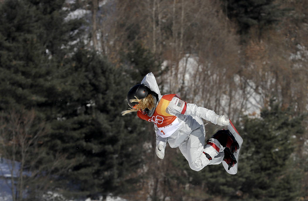 Chloe Kim, of the United States, jumps during the women's halfpipe finals at Phoenix Snow Park at the 2018 Winter Olympics in Pyeongchang, South Korea, Tuesday, Feb. 13, 2018. (AP Photo/Kin C ...