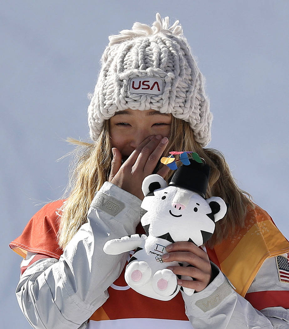 Chloe Kim, of the United States, wipes away a tear after winning gold in the women's halfpipe finals at Phoenix Snow Park at the 2018 Winter Olympics in Pyeongchang, South Korea, Tuesday, Feb ...