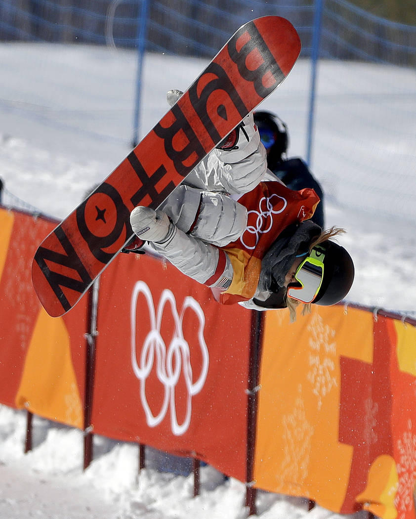 Chloe Kim, of the United States, jumps during the women's halfpipe finals at Phoenix Snow Park at the 2018 Winter Olympics in Pyeongchang, South Korea, Tuesday, Feb. 13, 2018. (AP Photo/Grego ...
