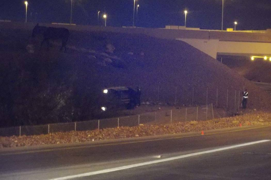 An AMR ambulance transporting a patient rolled over on the ramp leading from northbound I-15 to the westbound 215 Beltway Tuesday morning killing a first responder and the patient. (Max Michor/Las ...