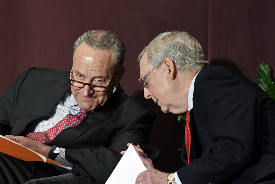 Senate Minority Leader Charles Schumer, D-N.Y., left, talks with Senate Majority Leader Mitch McConnell, R-Ky., before his speech at the McConnell Center's Distinguished Speaker Series Monday, Feb ...