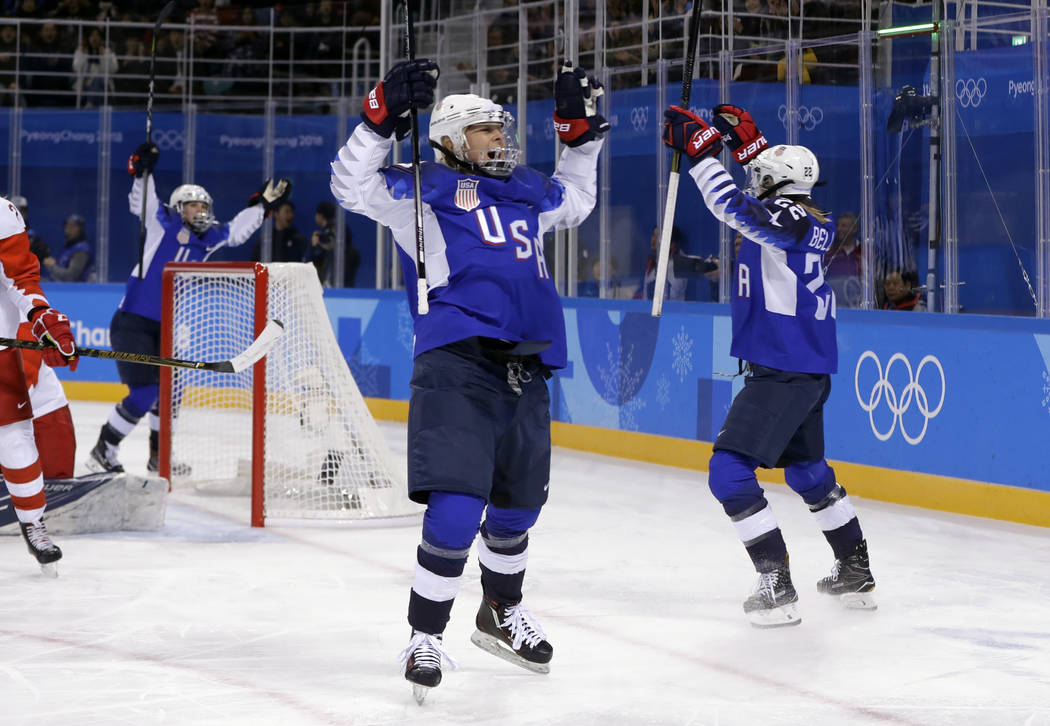 Players from the United States celebrate after Kacey Bellamy scores a goal against the team from Russia during the first period of the preliminary round of the women's hockey game at the 2018 Wint ...