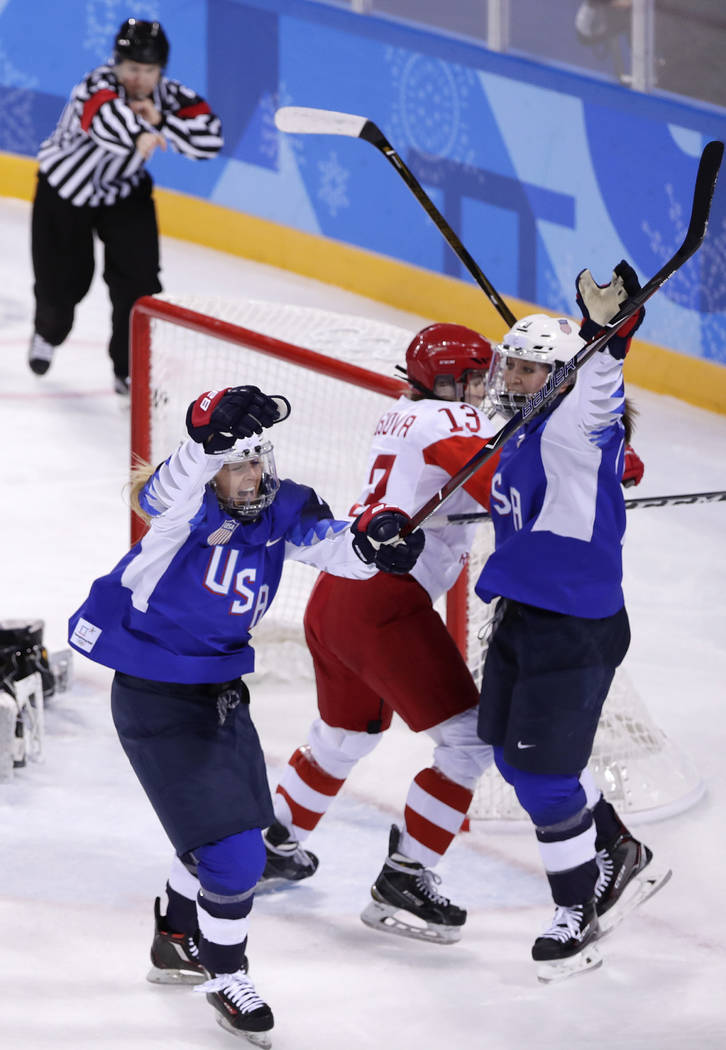 Gigi Marvin, left, of the United States, reacts after scoring a goal during the second period of the preliminary round of the women's hockey game against the team from Russia at the 2018 Winter Ol ...
