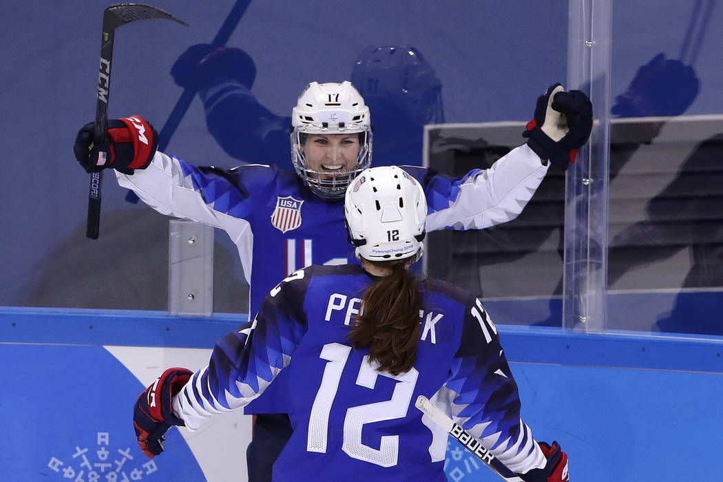 Jocelyne Lamoureux-Davidson (17), of the United States, celebrates her second goal against the team from Russia with Kelly Pannek (12) during the second period of the preliminary round of the wome ...