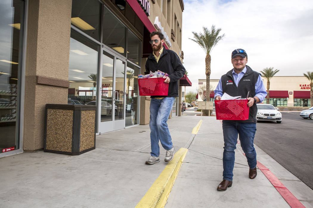 Members of the Republican Party of Nevada Will Sexauer, deputy state director, left, and Seb Rougemont, regional field director, deliver crumb cakes to Nevada Democratic Rep. Jacky Rosen's office  ...