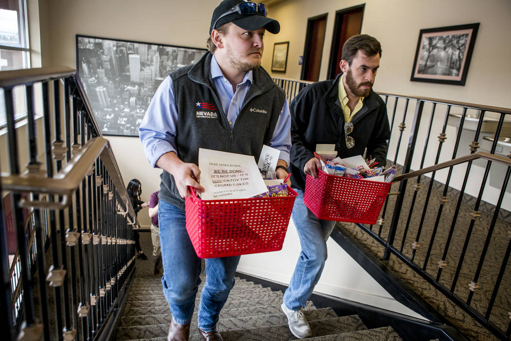 Members of the Republican Party of Nevada Seb Rougemont, regional field director, left, and Will Sexauer, deputy state director, deliver crumb cakes to Nevada Democratic Rep. Jacky Rosen's office  ...