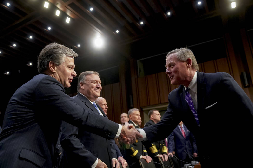 Chairman Richard Burr, R-N.C., right, greets FBI Director Christopher Wray, left, before a Senate Select Committee on Intelligence hearing on worldwide threats, Tuesday, Feb. 13, 2018, in Washingt ...