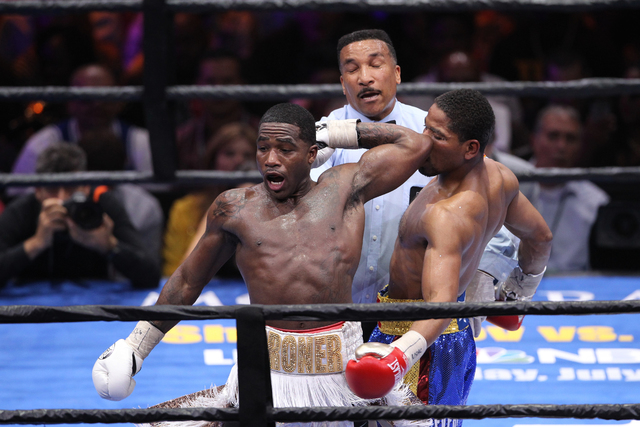 Adrien Broner, left, swings his arm back for a punch against his opponent Shawn Porter in their welterweight bout at the MGM Grand Garden Arena in Las Vegas Saturday, June 20, 2015. Porter won by  ...