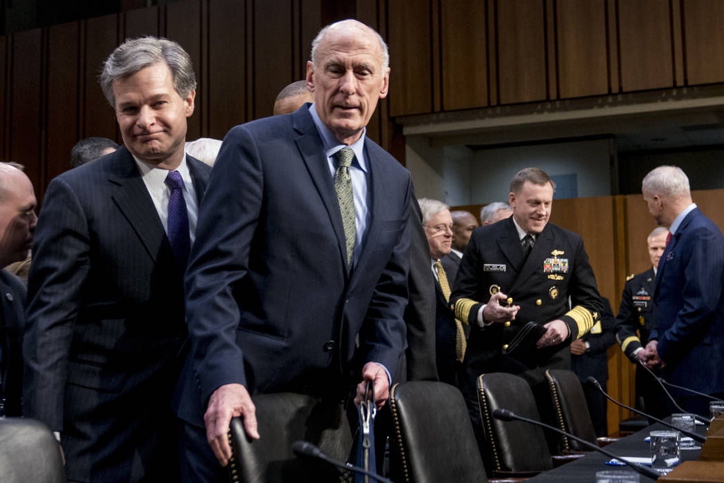 FBI Director Christopher Wray, left, and Director of National Intelligence Dan Coats, second from left, arrive for a Senate Select Committee on Intelligence hearing on worldwide threats, Tuesday,  ...