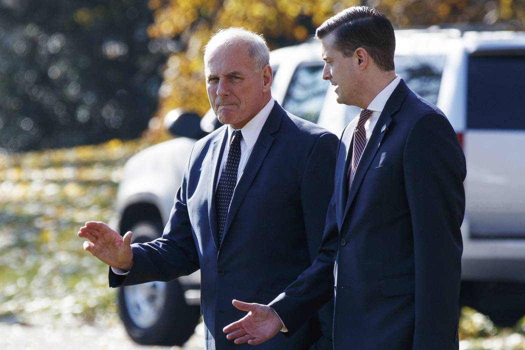 White House Chief of Staff John Kelly, left, walks with White House staff secretary Rob Porter to board Marine One on the South Lawn of the White House in Washington on Nov. 29, 2017. (AP Photo/Ev ...