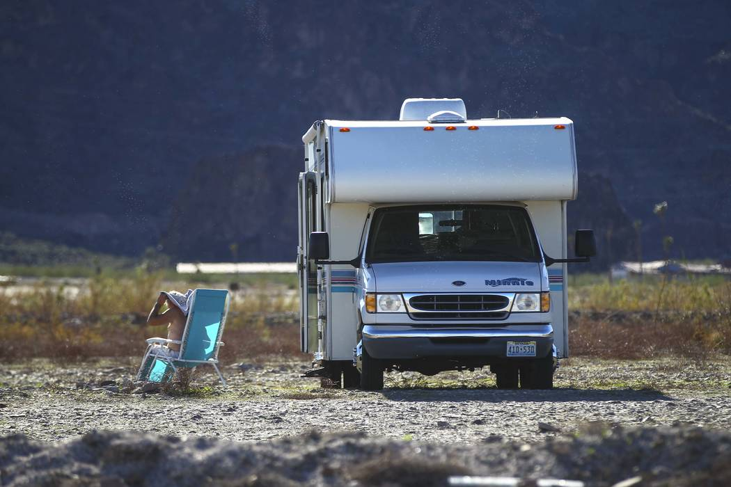 A man relaxes by an RV at Boulder Beach at Lake Mead National Recreation Area on Tuesday, Feb. 14, 2017. (Chase Stevens/Las Vegas Review-Journal) @csstevensphoto