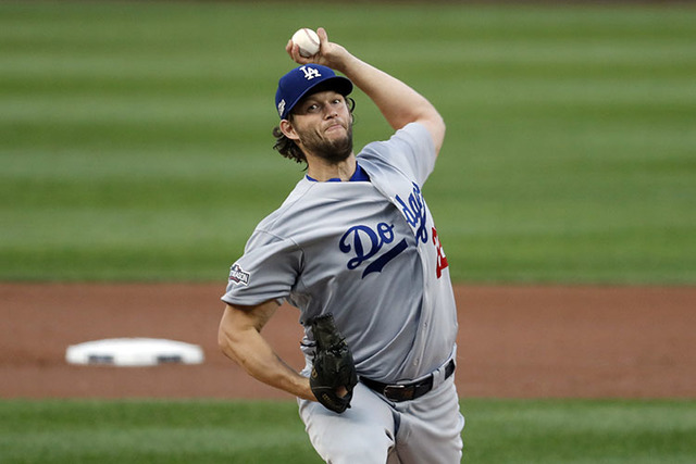 Los Angeles Dodgers starting pitcher Clayton Kershaw throws during Game 1 of baseball's National League Division Series against the Washington Nationals, at Nationals Park, Friday, Oct. 7, 2016, i ...