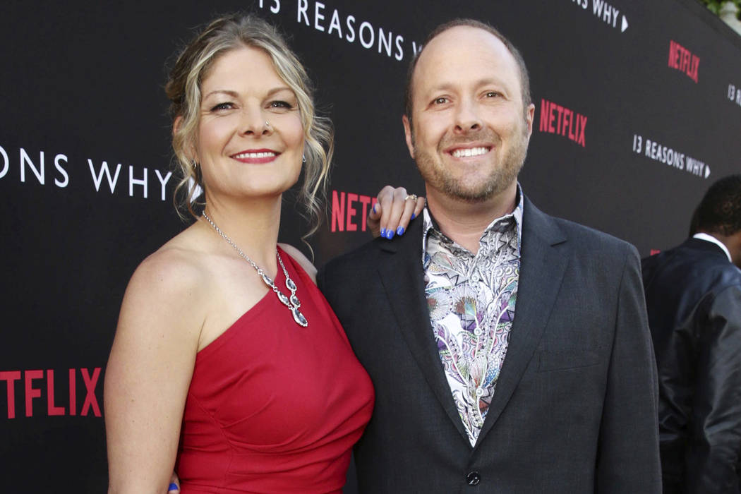 "Joan Marie and Author Jay Asher appear at the Netflix ""13 Reasons Why"" premiere in Los Angeles. (Steve Cohn/Netflix via AP)"