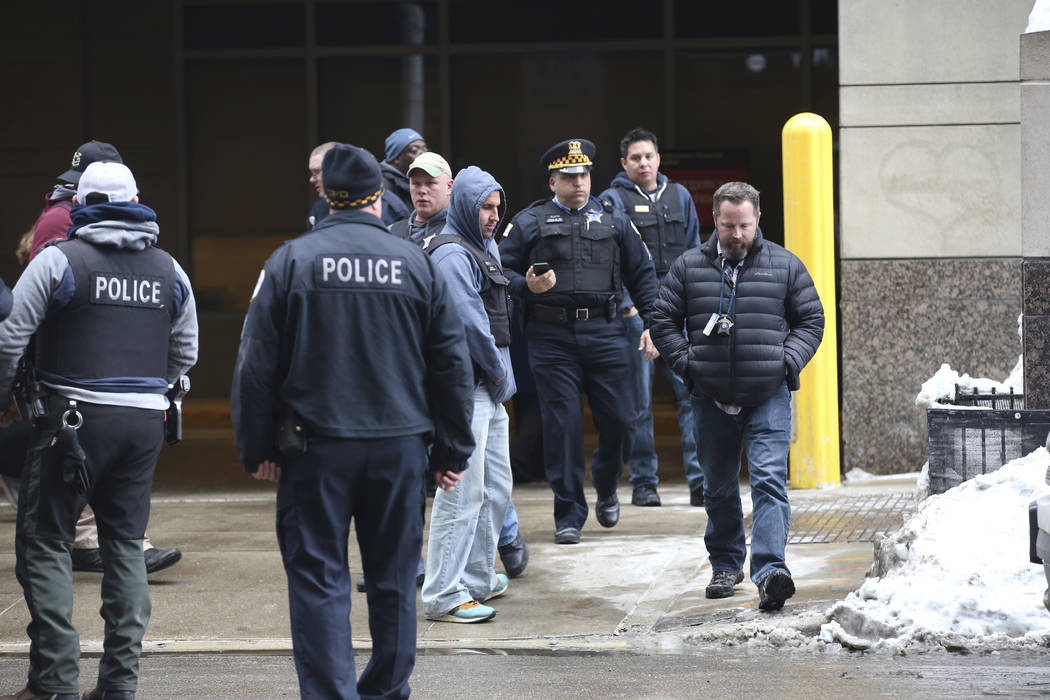 Chicago Police officers arrive at Northwestern Memorial Hospital emergency room, where an high-ranking Chicago Police officer was brought in code red, serious to critical condition, after being sh ...