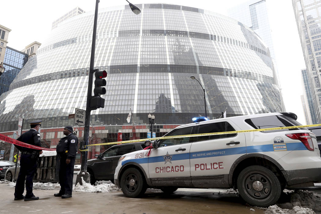 Police guard the crime scene after an off-duty Chicago police officer was shot at the James R. Thompson Center, in Chicago, Tuesday, Feb. 13, 2018. (John J. Kim/Chicago Tribune via AP)