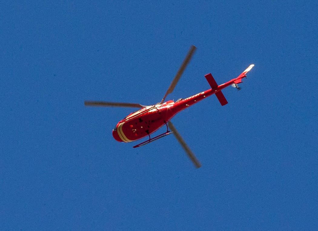 A helicopter flies over East Diamond Bar Road on the Hualapai Nation Indian Reservation in Arizona on Sunday, Feb. 11, 2018.  Patrick Connolly Las Vegas Review-Journal @PConnPie