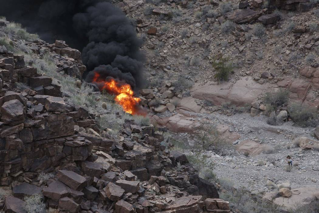 The scene of a deadly tour helicopter crash in the Grand Canyon, Arizona, Saturday, Feb. 10, 2018. The crash killed three people and injured four others. (Teddy Fujimoto)
